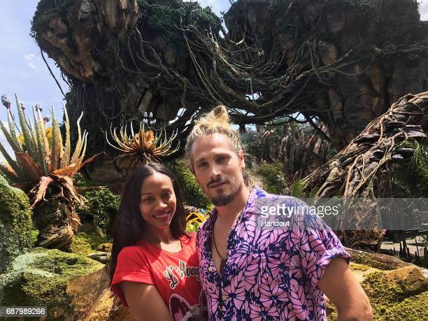 In this handout photo provided by Disney Resorts actress Zoe Saldana and husband Marco Perego attend the dedication ceremony for the new Pandora...