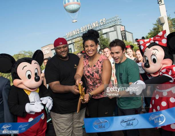 In this handout photo provided by Disney Resorts 'American Idol' winners Ruben Studdard Jordin Sparks and Kris Allen cut the celebratory ribbon with...