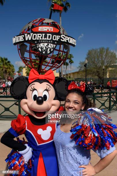 In this handout photo provided by Disney Resorts Gymnast Laurie Hernandez poses with Minnie Mouse during the D2 Summit Championship at the ESPN Wide...