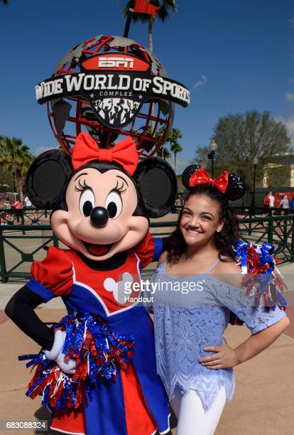 In this handout photo provided by Disney Resorts, Gymnast Laurie Hernandez poses with Minnie Mouse during the D2 Summit Championship at the ESPN Wide...