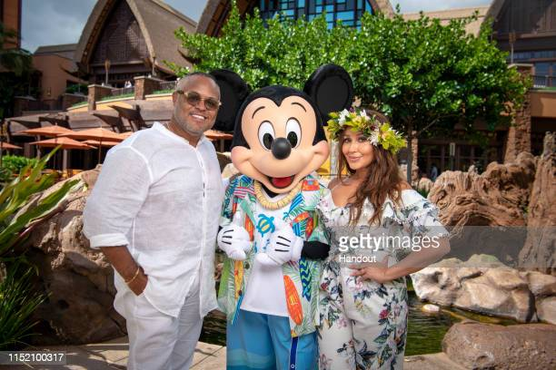 In this handout photo provided by Disney Resorts Host of The Real and former Cheetah Girl Adrienne Bailon Houghton and husband Isreal Houghton visit...