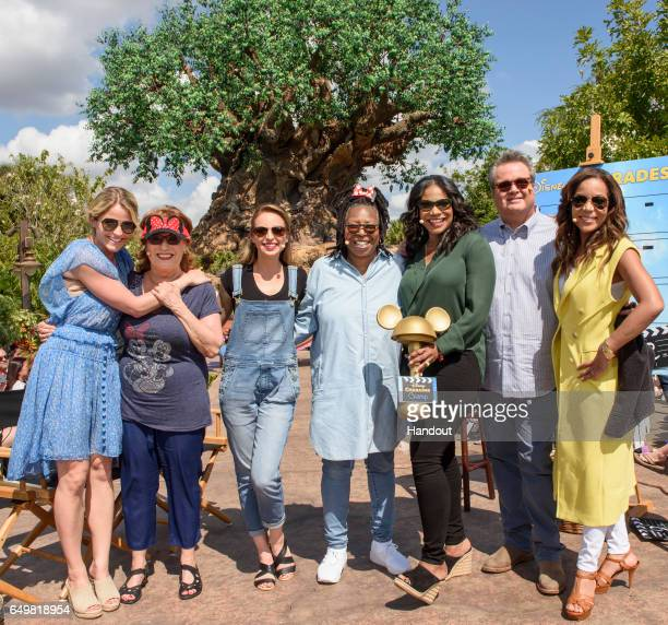 In this handout photo provided by Disney Resorts hosts Sara Haines Joy Behar Jedediah Bila Whoopi Goldberg and Sunny Hostin pose with guests Audra...