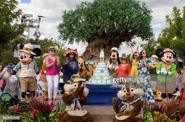 In this handout photo provided by Disney Resorts hosts Sara Haines Whoopi Goldberg Joy Behar Paula Farris and Sunny Hostin celebrate with Disney...
