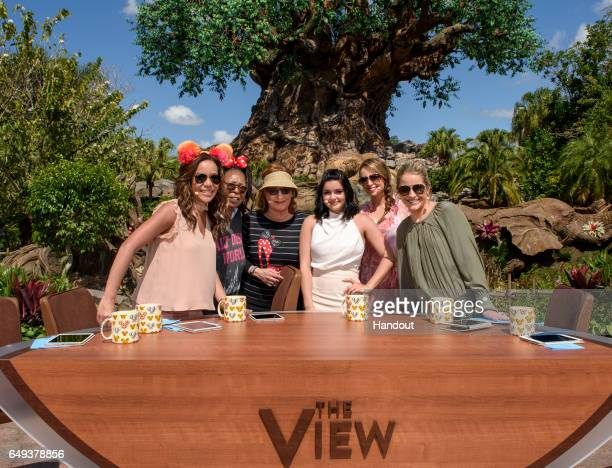 In this handout photo provided by Disney Resorts hosts Sunny Hostin Whoopi Goldberg Joy Behar Jedediah Bila and Sara Haines pose with guest Ariel...