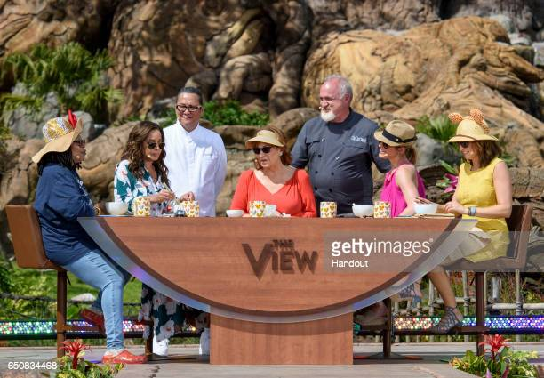 In this handout photo provided by Disney Resorts hosts Whoopi Goldberg Sunny Hostin Joy Behar Sara Haines and Paula Farris speak with chef Masaharu...