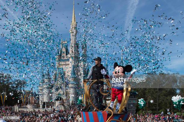 In this handout photo provided by Disney Resorts Nick Foles of the Super Bowl LII winning team the Philadelphia Eagles celebrates in a Main Street...