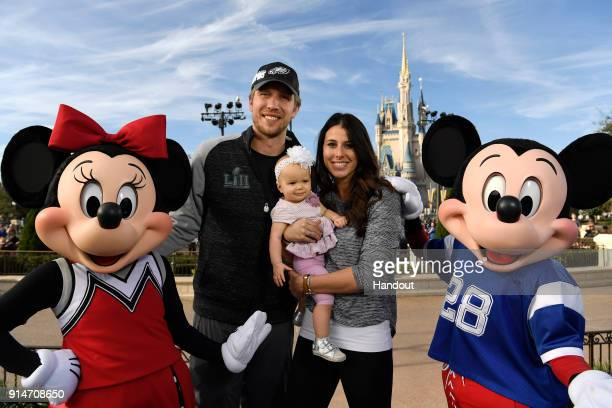 In this handout photo provided by Disney Resorts, Nick Foles of the Super Bowl LII winning team, the Philadelphia Eagles with his wife Tori Foles and...