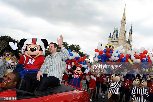 In this handout photo provided by Disney Super Bowl XLV Most Valuable Player Aaron Rodgers takes a celebratory ride with Mickey Mouse following the...