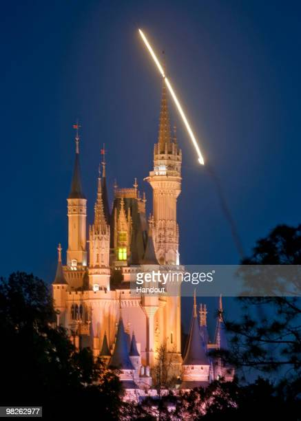 In this handout photo provided by Disney the Space Shuttle Discovery is seen lifting off over Cinderella Castle at the Magic Kingdom on April 5 2010...