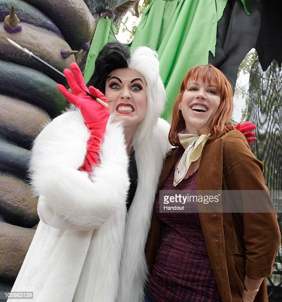 In this handout photo provided by Disneyland Molly Ringwald celebrates Halloween Time with Cruella de Vil at Disneyland on October 22 2010 in Anaheim...