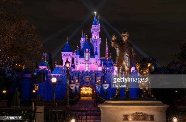 In this handout photo provided by Disneyland Resort, a view of Sleeping Beauty Castle in Disneyland Park illuminated during a special live streamed...