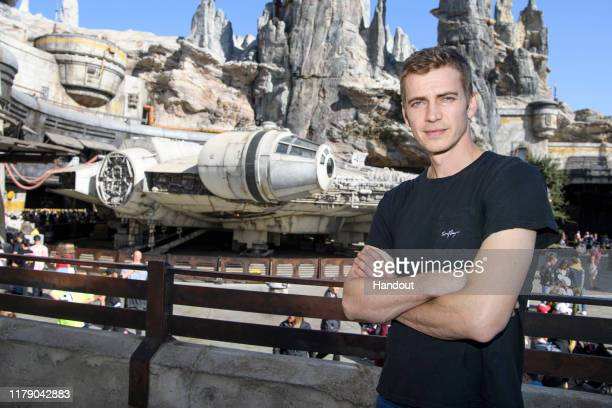 In this handout photo provided by Disneyland Resort actor Hayden Christensen poses in front of the Millennium Falcon Smugglers Run in Star Wars...