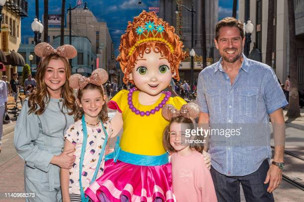 In this handout photo provided by Disneyland Resort actress Alyson Hannigan poses with her daughter Satyana Disney Junior star Fancy Nancy daughter...