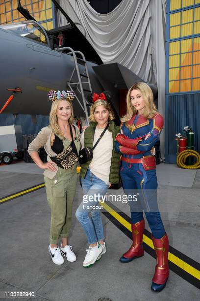In this handout photo provided by Disneyland Resort, actresses and friends Sarah Michelle Gellar and Selma Blair share a special moment with Captain...