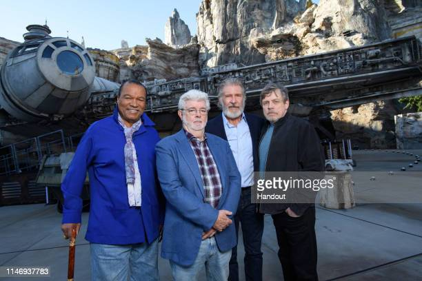 In this handout photo provided by Disneyland Resort Billy Dee Williams George Lucas Harrison Ford and Mark Hamill attend the preopening launch of...