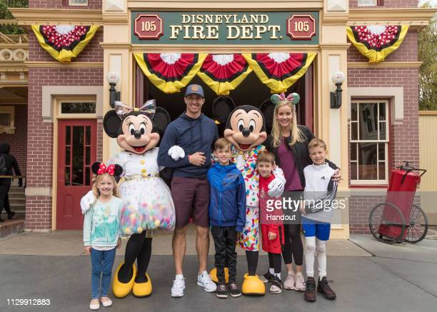 In this handout photo provided by Disneyland Resort, Drew Brees, quarterback for the New Orleans Saints, his wife, Brittany Brees, and their four...