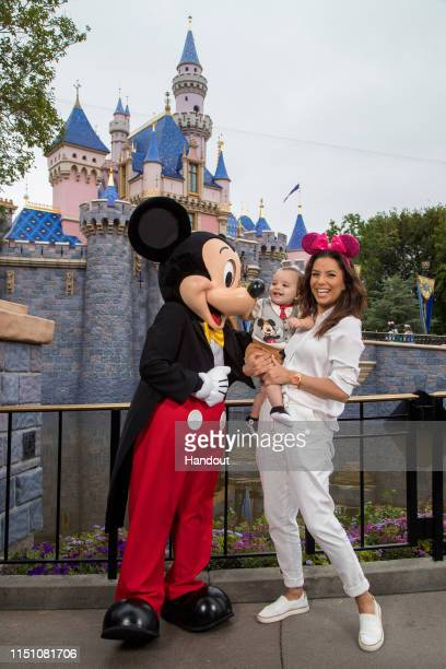 In this handout photo provided by Disneyland Resort Eva Longoria and her son Santiago Enrique Bastón celebrate his first birthday and first encounter...