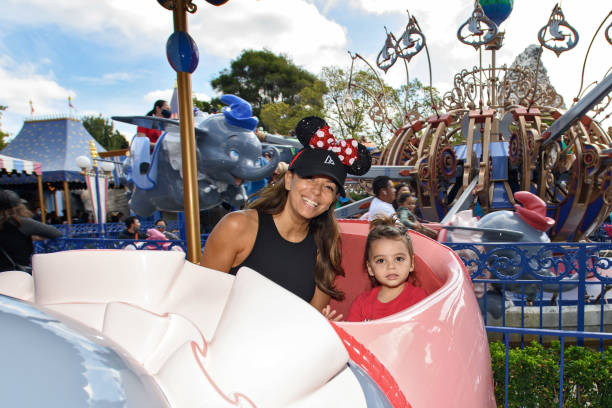 CA: Actress Eva Longoria Visits Disneyland Park With Her Son Santiago Enrique Bastón