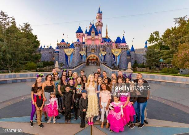 In this handout photo provided by Disneyland Resort, in the midst of Halloween Time at Disneyland Resort, actress Elle Fanning, who plays Aurora in...