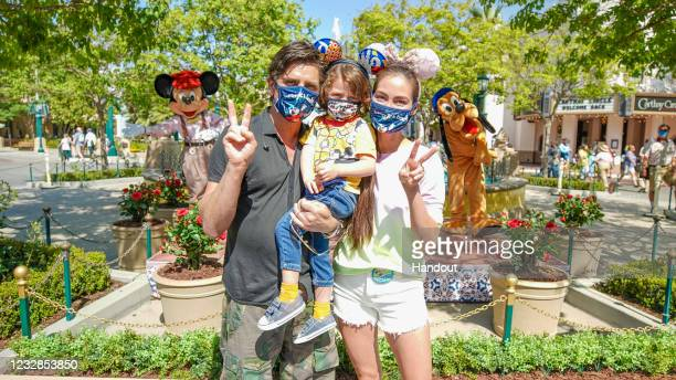 John Stamos and son Billy celebrate Caitlin McHugh Stamos's birthday at Disney California Adventure Park in Anaheim, California on May 12, 2021. They...