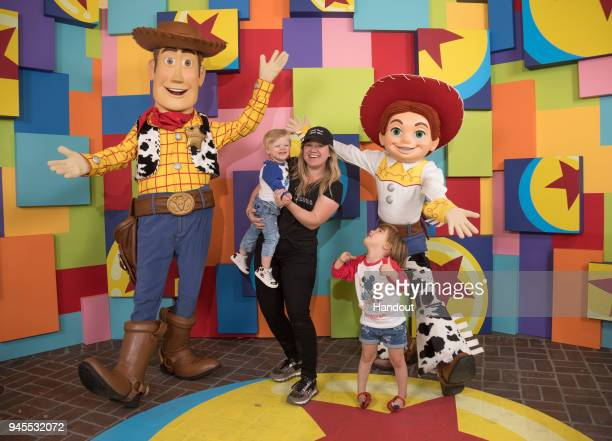 In this handout photo provided by Disneyland Resort singer Kelly Clarkson and her children Remington Alexander and River Rose visit with Pixar pals...