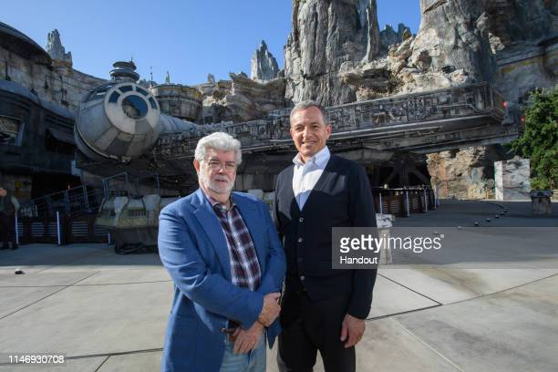 In this handout photo provided by Disneyland Resort, Walt Disney Company Chairman and CEO Bob Iger , andStar Warscreator George Lucas stand in...