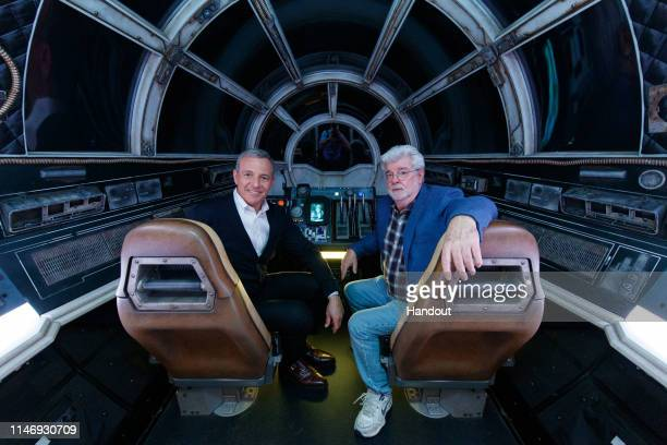 In this handout photo provided by Disneyland Resort, Walt Disney Company Chairman and CEO Bob Iger , andStar Warscreator George Lucas pose inside...