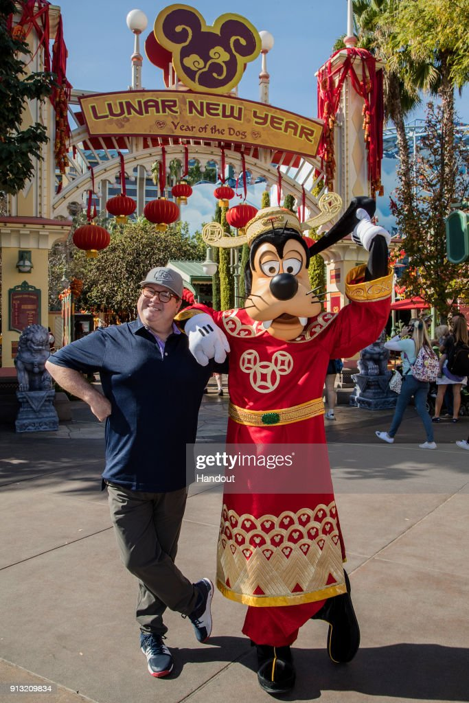 In this handout photo provided by Disneyland Resorts, actor Eric Stonestreet poses with Goofy, dressed in 'god of Good Fortune' garments, during the Lunar New Year Celebration at Disney California Adventure Park on February 01, 2018 in Anaheim, California. Mulan's Lunar New Year Procession, celebrating the Year of The Dog, continues at the park until February 18th.