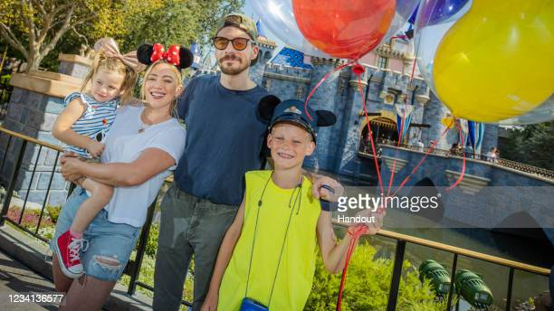 In this handout photo provided by Disneyland Resorts, Hilary Duff with her husband, singer-songwriter Matthew Koma, their daughter Banks and Duff's...