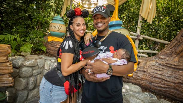 CA: Ne-Yo And Crystal Renay Visit Disneyland Resort With Daughter Isabella Rose