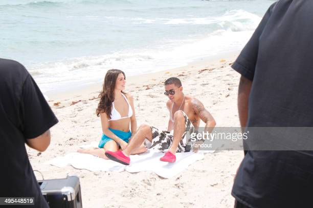 In this handout photo provided by Doug Mendonca Isis Valverde and TTrick are seen on the set of a music video at Boca Raton Resort May 31 2014 in...