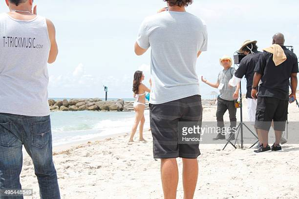 In this handout photo provided by Doug Mendonca Isis Valverde is seen on the set of a music video at Boca Raton Resort May 31 2014 in Boca Raton...