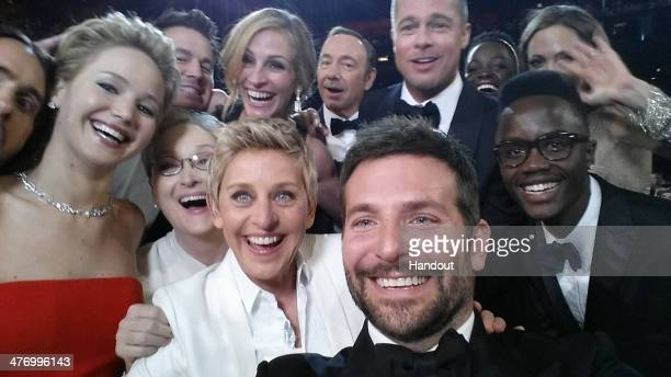 ONLY In this handout photo provided by Ellen DeGeneres host Ellen DeGeneres poses for a selfie taken by Bradley Cooper with Jared Leto Jennifer...
