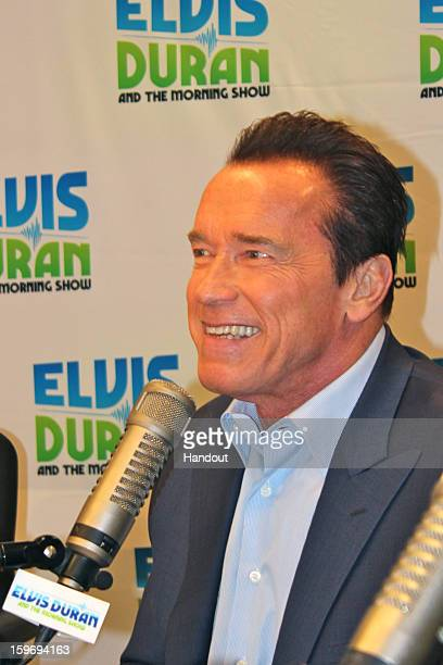 In this handout photo provided by Elvis Duran and the Morning Show Arnold Schwarzenegger and Jaimie Alexander speak with Elvis Duran on 'Elvis Duran...