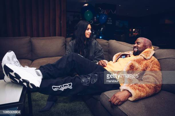 In this handout photo provided by Forum Photos, Kim Kardashian West and Kanye West attend the Travis Scott Astroworld Tour at The Forum on December...