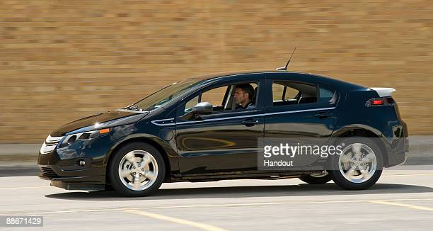 In this handout photo provided by General Motors Chevrolet Volt Vehicle Chief Engineer Andrew Farah takes the first preproduction Volt for a drive...