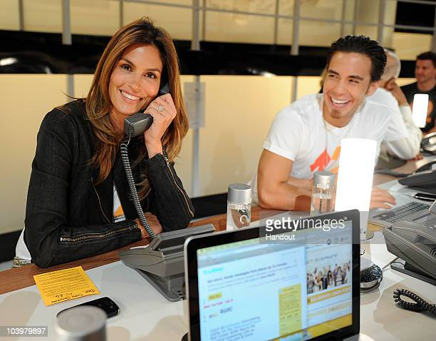 In this handout photo provided by Getty Images model Cindy Crawford and olympic medalist Apolo Ohno pose during Stand Up To Cancer at Sony Pictures...