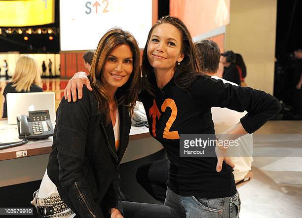 In this handout photo provided by Getty Images model Cindy Crawford and actress Diane Lane pose during Stand Up To Cancer at Sony Pictures Studios on...
