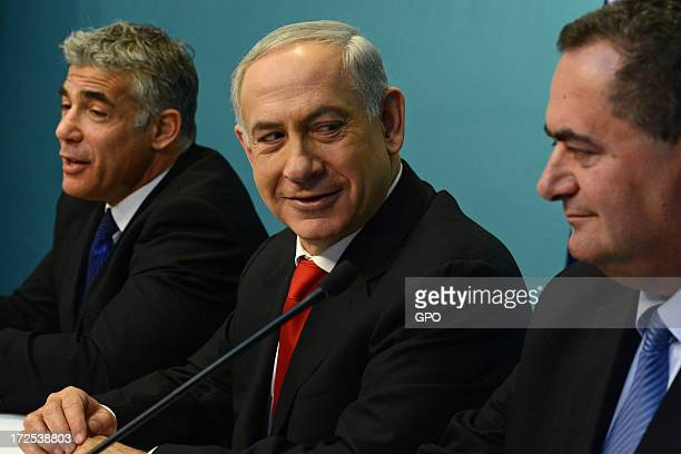 In this handout photo provided by GPO Finance Minister Yair Lapid Prime Minister Benjamin Netanyahu and Transportation Minister Yisrael Katz during a...