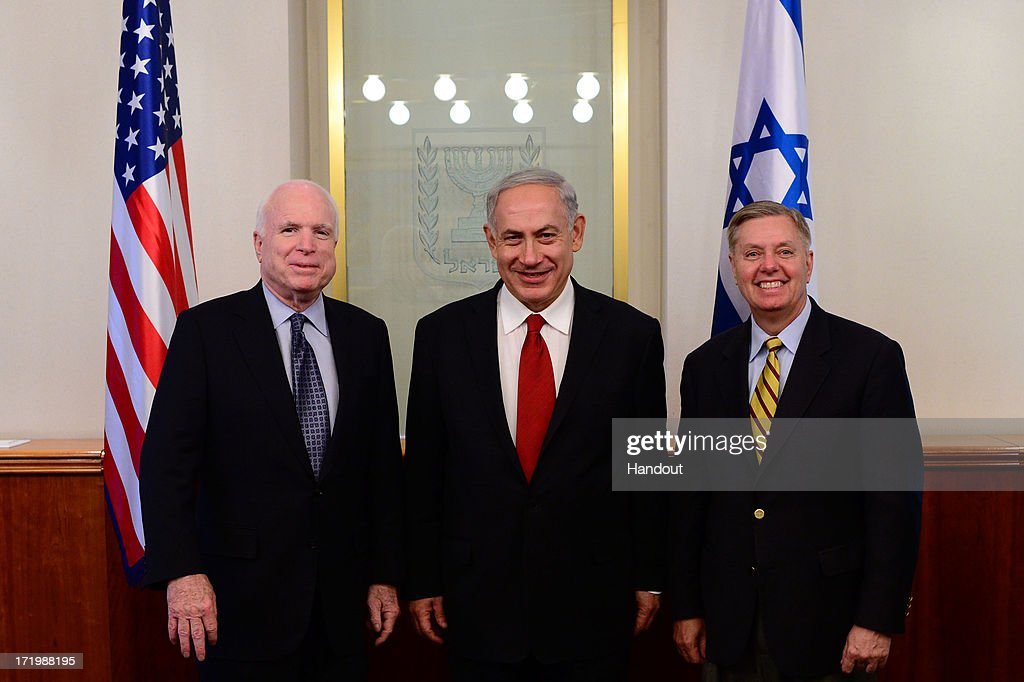 In this handout photo provided by GPO, U.S. Senators Lindsey Graham (R) and John McCain (R-AZ) meet with Israeli Prime Minister Benjamin Netanyahu (C) on June 30, 2013 in Jerusalem, Israel.