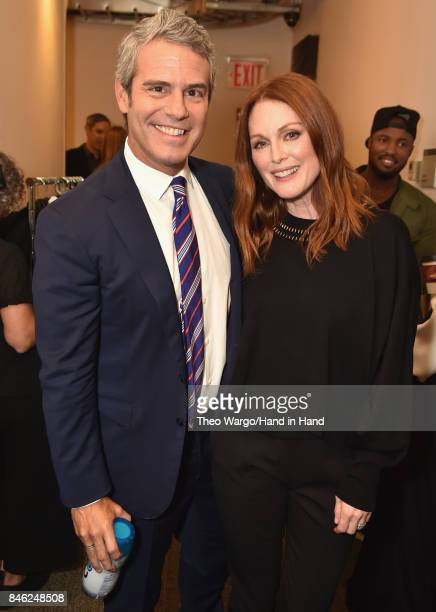 In this handout photo provided by Hand in Hand, Andy Cohen and Julianne Moore caption at ABC News' Good Morning America Times Square Studio on...