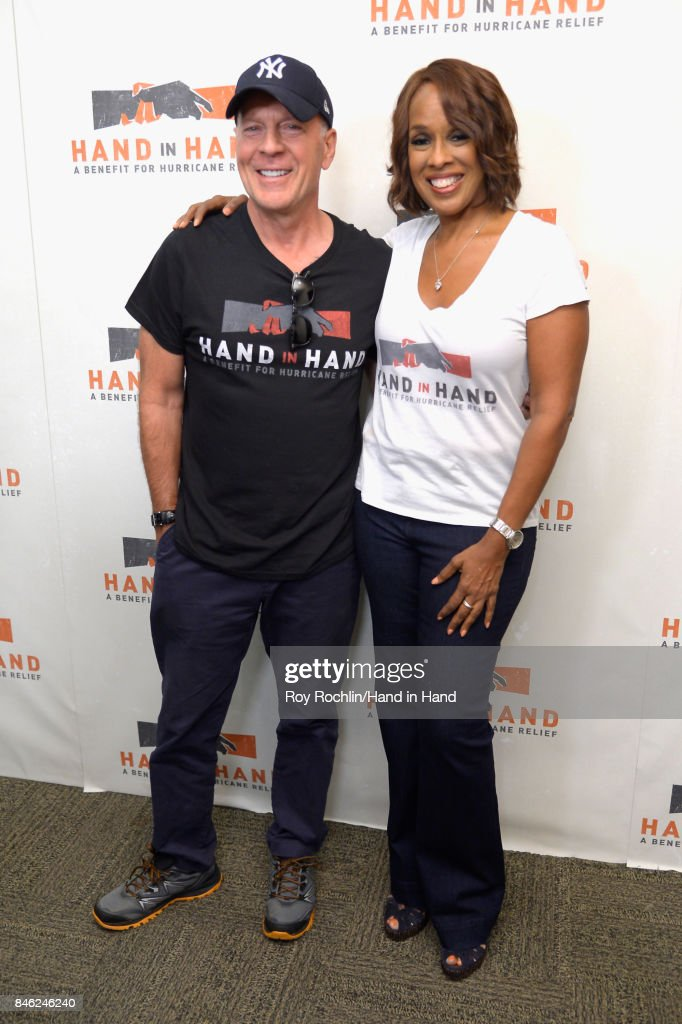 In this handout photo provided by Hand in Hand, Bruce Willis and Gayle King caption at ABC News' Good Morning America Times Square Studio on September 12, 2017 in New York City.
