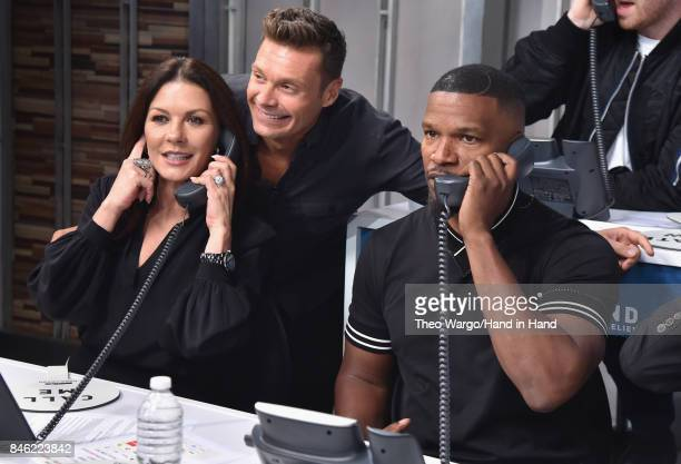 In this handout photo provided by Hand in Hand, Catherine Zeta-Jones, Ryan Seacrest, Jamie Fox attends Hand in Hand: A Benefit for Hurricane Relief...