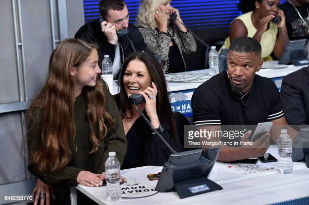 In this handout photo provided by Hand in Hand, Catherine Zeta-Jones, Ryan Seacrest, Jamie Fox caption at ABC News' Good Morning America Times Square...