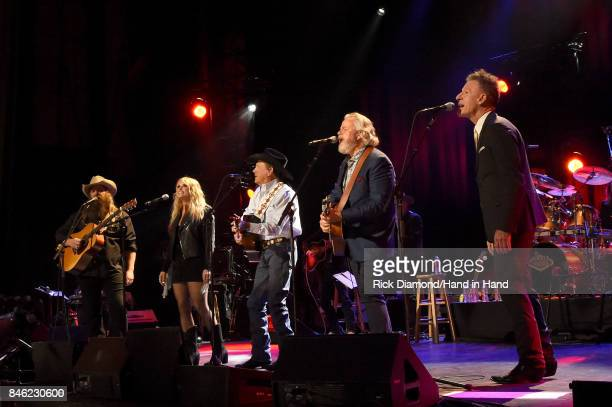 In this handout photo provided by Hand in Hand, Chris Stapleton, Miranda Lambert, George Strait, Lyle Lovett and Robert Early Keen perform onstage...