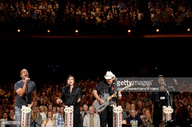 In this handout photo provided by Hand in Hand Darius Rucker Demi Lovato Brad Paisley and CeCe Winans perform onstage during Hand in Hand A Benefit...