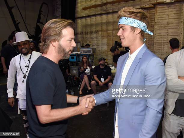 In this handout photo provided by Hand in Hand David Spade and Justin Bieber attend Hand in Hand A Benefit for Hurricane Relief at Universal Studios...