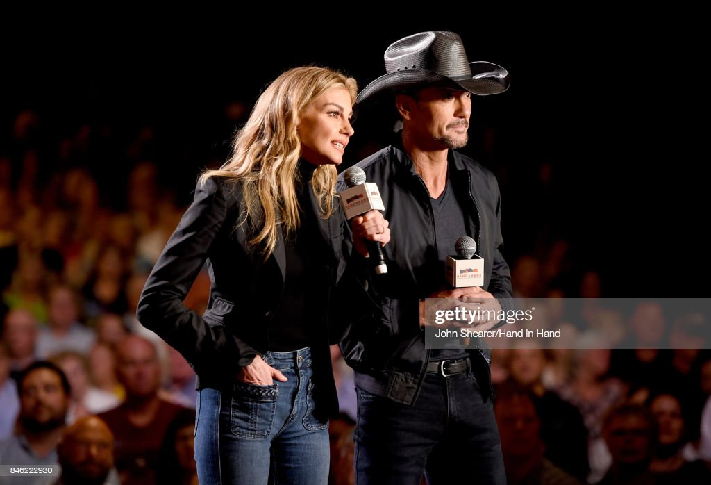 In this handout photo provided by Hand in Hand, Faith Hill and Tim McGraw speak onstage during Hand in Hand: A Benefit for Hurricane Relief at the Grand Ole Opry House on September 12, 2017 in Nashville, Tennessee.