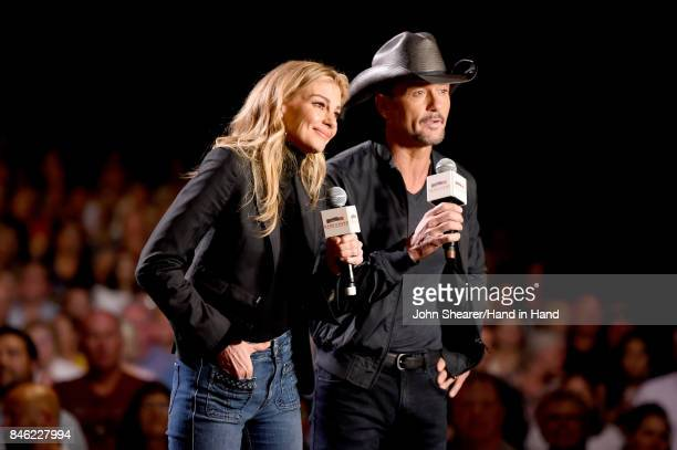 In this handout photo provided by Hand in Hand Faith Hill and Tim McGraw speak onstage during Hand in Hand A Benefit for Hurricane Relief at the...