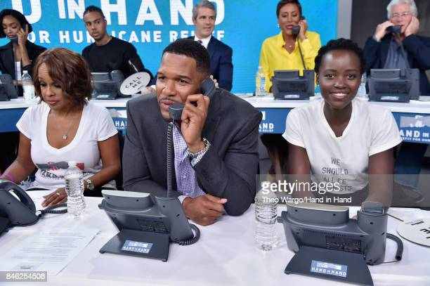 In this handout photo provided by Hand in Hand, Gayle King, Michael Strahan and Lupita Nyong'o caption at ABC News' Good Morning America Times Square...